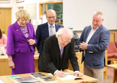 President Higgins signs copy of his book held in MCMS